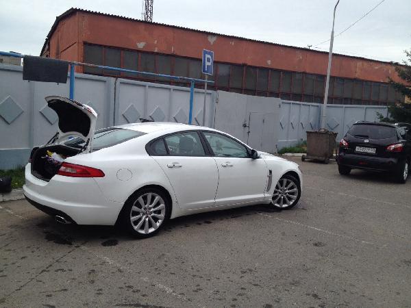 Перевозка автомобиля ягуар xf из Омск в Санкт-Петербург